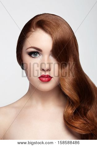 Ginger red long hair.Fashion portrait red lips on white background