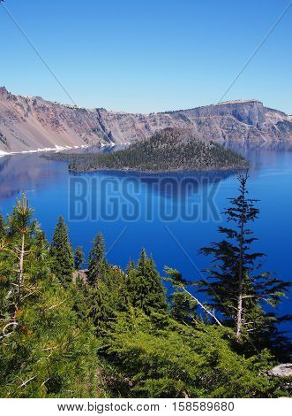 Wizard Island in Crater Lake on a sunny summer morning.