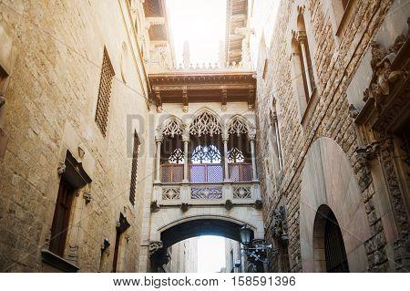 Barcelona Spain medieval bridge in Carrer del Bisbe street Barri Gotic