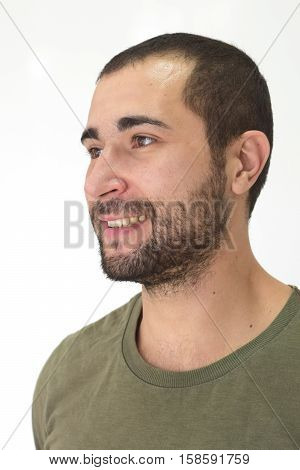 A young handsome unshaven man smiling happily