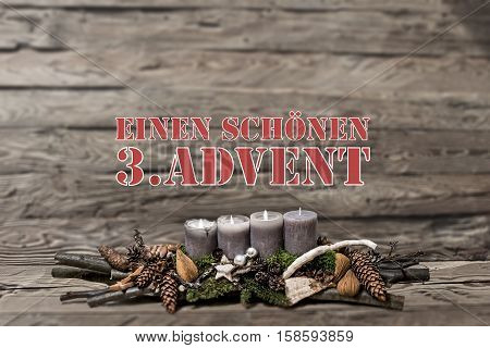 Merry Christmas decoration advent with burning grey candle Blurred background text message german 3rd