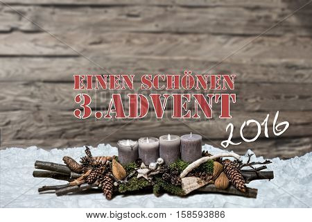 Merry Christmas decoration advent 2016 with burning grey candle Blurred background snow text message german 3rd