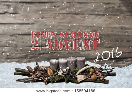 Merry Christmas decoration advent 2016 with burning grey candle Blurred background snow text message german 2nd