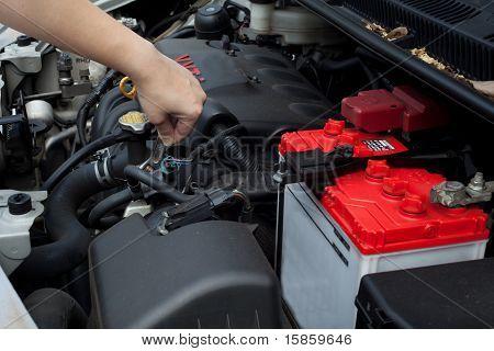repairs a car