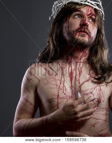 Resurrection, Jesus christ, jesus of nazareth with the crown of thorns and blood for his body as penance before the crucifixion