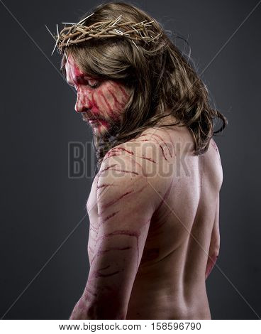 Faith, Jesus christ, jesus of nazareth with the crown of thorns and blood for his body as penance before the crucifixion