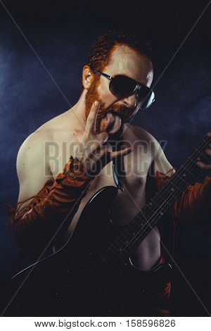Performer, Rock star with electric guitar and concert hall smoke environment