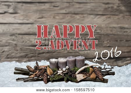 Merry Christmas decoration advent 2016 with burning grey candle Blurred background snow text message englisch 2nd