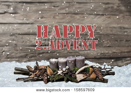 Merry Christmas decoration advent with burning grey candle Blurred background snow text message englisch 2nd