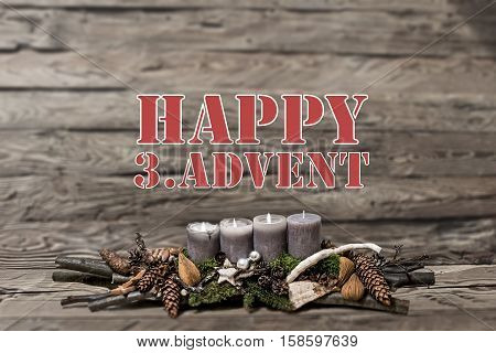 Merry Christmas decoration advent 2016 with burning grey candle Blurred background text message englisch 3rd