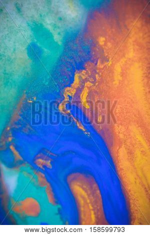 spreads colored ink colors on white background. Abstractly spreads dye ink red, green, yellow, orange, blue background on paper. Art Creative abstract background. Colorful background