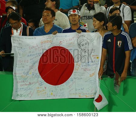 RIO DE JANEIRO, BRAZIL - AUGUST 14, 2016: Japanese fans support Kei Nishikori of Japan during men's singles tennis medal ceremony of the Rio 2016 Olympic Games