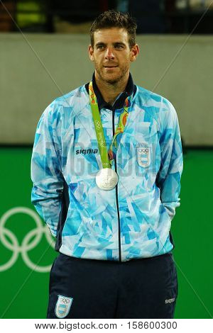 RIO DE JANEIRO, BRAZIL - AUGUST 14, 2016: Silver medalist Juan Martin Del Potro of Argentina during tennis men's singles medal ceremony of the Rio 2016 Olympic Games at the Olympic Tennis Centre