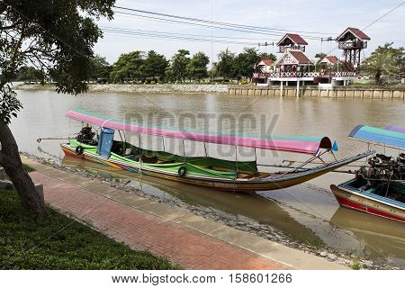 AYUTTHAYA, THAILAND - November 4, 2016: View of a long tail boat a type of watercraft native to Southeast Asia which uses a common automotive engine in the Chao Phraya River Thailand