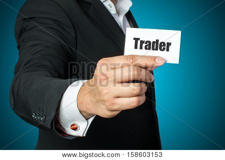 Businessman with trader card on chest in black suit
