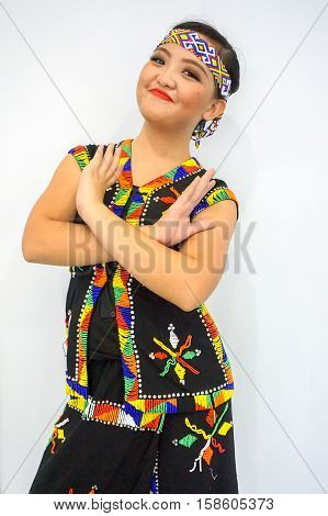 Labuan,Malaysia-Nov,2016:Bidayuh lady in traditional costumes ready to performing dancing during Borneo festival in Labuan.Bidayuh Sarawak or Land Dayak is one of the minority's ethnic in Sarawak.