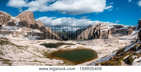 Snow and mountain lake Lago dei Piani near Drei Zinnen or The cime, Italy Alps Dolomites