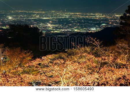 Autumn leaves and nightview of Isehara city from Mount Oyama in Kanagawa, Japan.