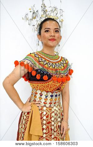 Labuan,Malaysia-Nov 26,2016:Lady from the Iban ethnic of Sarawak Borneo in traditional costume during Borneo festival in Labuan.The Iban community lived in longhouses located in Sarawak,Malaysia.