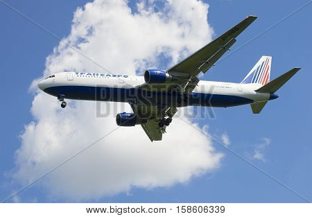 SAINT PETERSBURG, RUSSIA - JUNE 29, 2015: Aircraft Boeing 767-300 (EI-DBG) of the Transaero airline flies on the background of white clouds