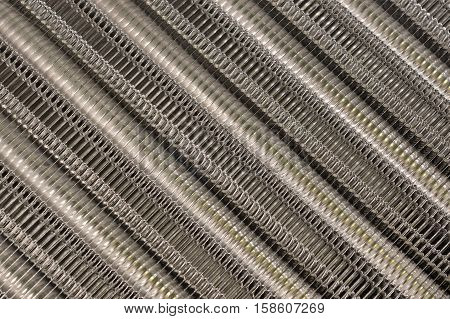Details of the car engine radiator. Macro close-up of the radiator plates.