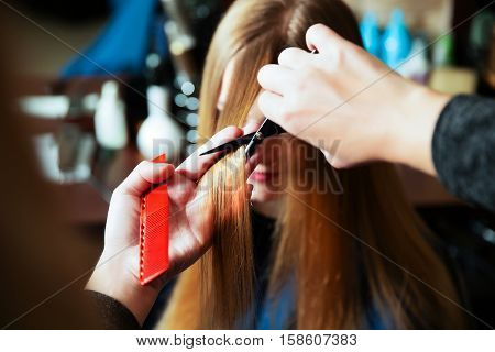 Young woman at hairdresser.