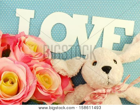 Love Word With Roses And Cute Doll Valentine Dat Concept