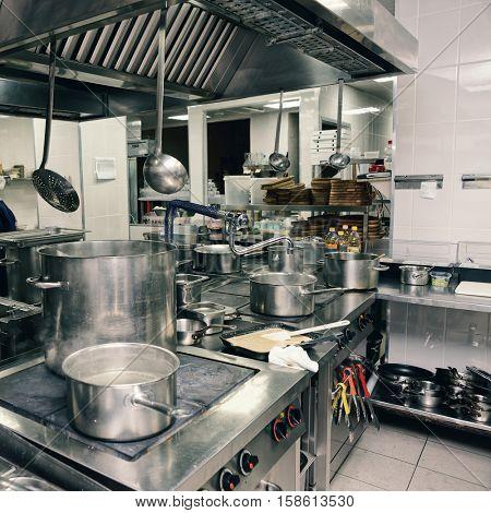 Professional kitchen interior, square image, toned image