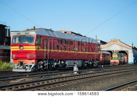 RYBINSK, RUSSIA - AUGUST 24, 2016: Passenger diesel locomotive TEP-70 at the building of the locomotive depot station Rybinsk