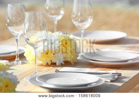 Table setting for buffet catering party outdoors, close up view