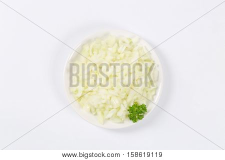plate of chopped raw onion on white background