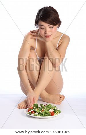 Beautiful girl with salad meal
