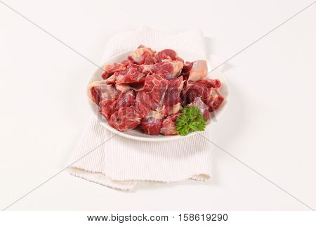 plate of diced raw beef meat on white place mat