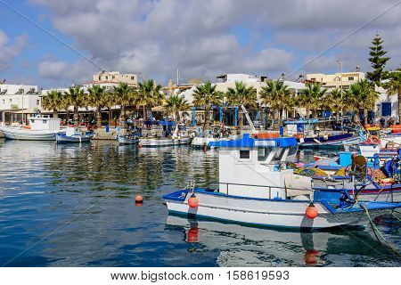 Kos island, Dodecanese, Greece - May 16, 2016: the scenic harbour with traditional fishing boats in the village of Kardamena.