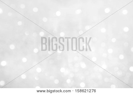 Soft Beautiful Abstract White Grey Background with Bokeh lights. Beautiful blurred Winter background with copy space. Grayscale Texture