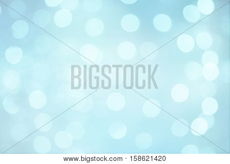 Bright Beautiful Abstract Blue White Background with Bokeh circles. Blurred Soft Texture with particles. Light spots on pale blue background defocused