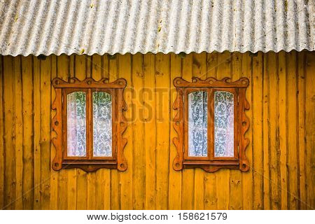 Two Windows In A Wooden House.