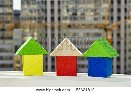 Wooden cubes  on a background of construction . The concept of affordable housing .