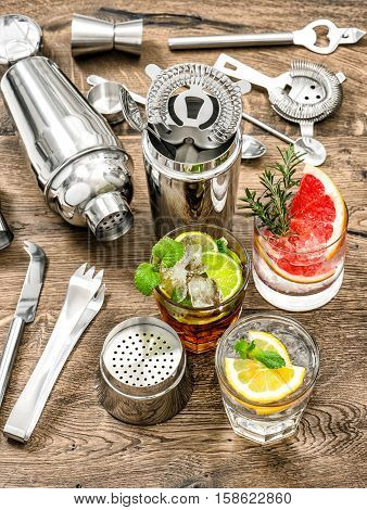 Cocktails with fruits and ice. Juice. Aperitif. Bar drink making tools