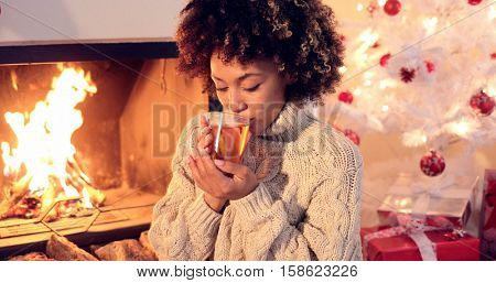Young woman drinking spicy lemon tea