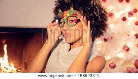 Fun vivacious young woman celebrating Christmas