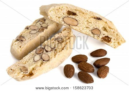 close up of biscotti pastries and almonds isolated over white