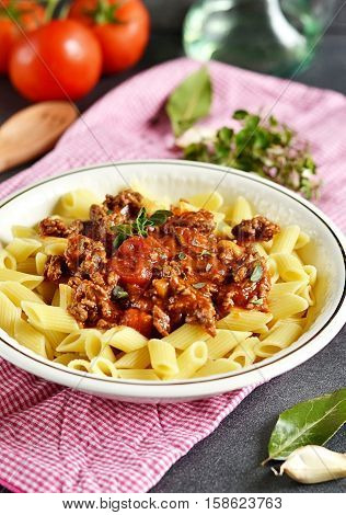 Pasta bolognese with ground beef and tomato sauce