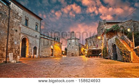 Sovana Grosseto Tuscany Italy: ancient square at dawn in the old town of the medieval village founded in Etruscan times