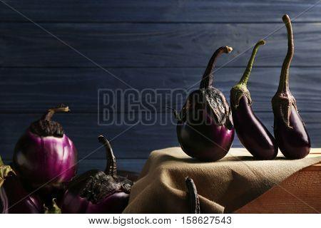 Fresh aubergines on wooden background