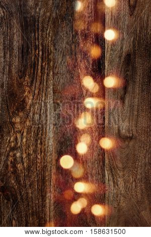 Dark wooden background vertical with yellow light dots for a concept