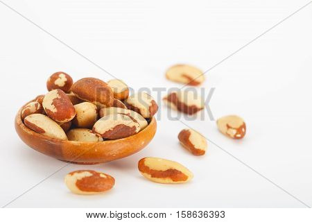 Brazil nuts (Bertholletia excelsa) on white background. Healthy snack.