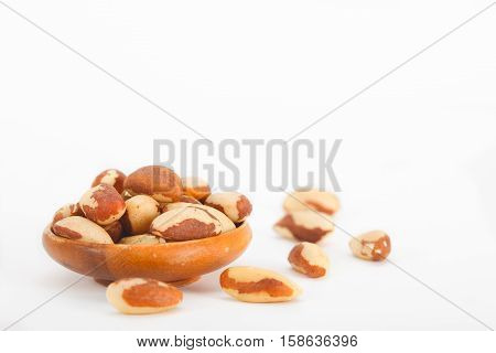 Bowl With Brazil Nut on white background. Bertholletia excelsa. Healthy food.