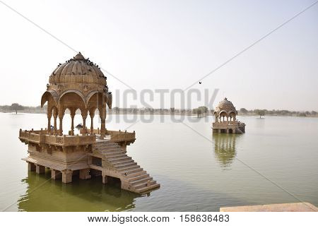 Cenotaphs inside Gadisar lake in Jaisalmer, Rajasthan, India