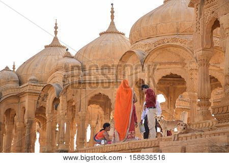 JAISALMER, RAJASTHAN, INDIA - FEBRUARY 11, 2016 - Cenotaphs and people in Bada Bagh cemetery